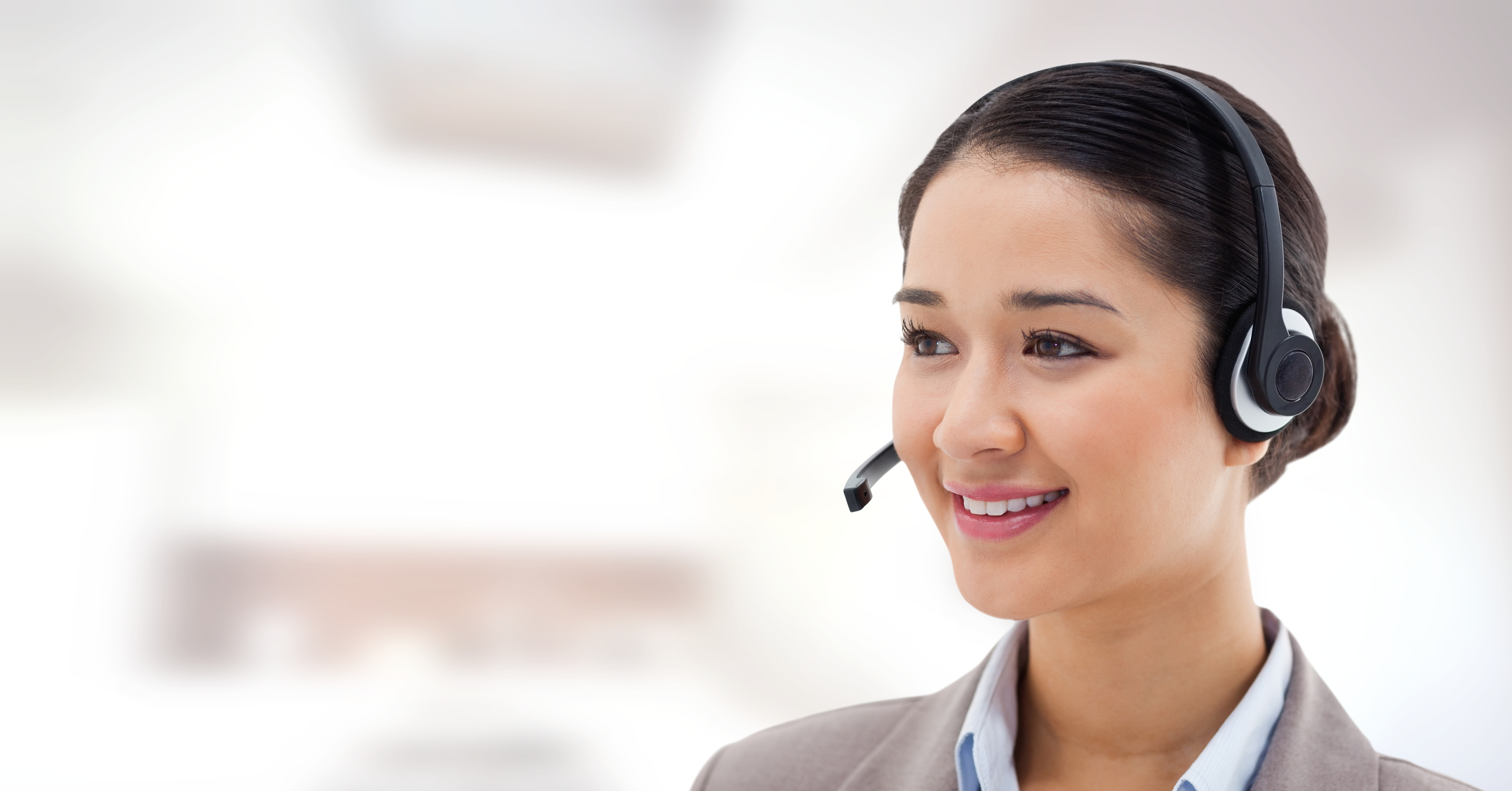 Digital composite of Customer service woman with bright background in call center